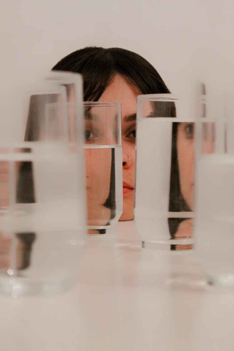 woman staring on glasses with water